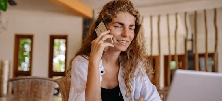 Woman using cellphone and smiling