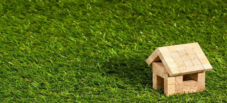 A wooden house on the grass