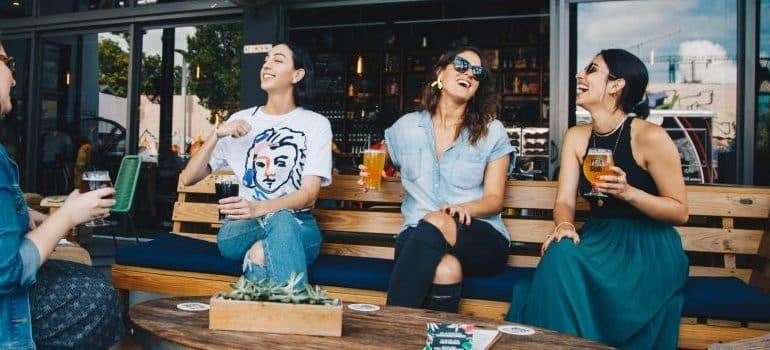 friends-sitting-talking-smiling