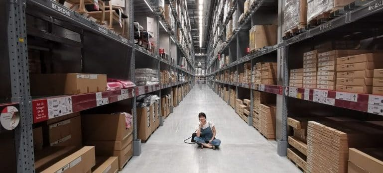 Woman sitting in the warehouse