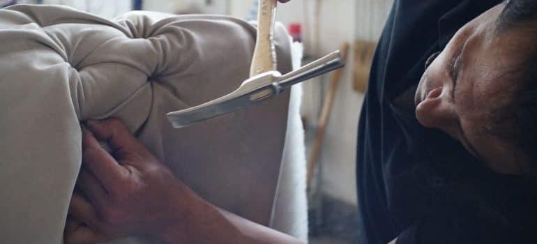 person fixing sofa
