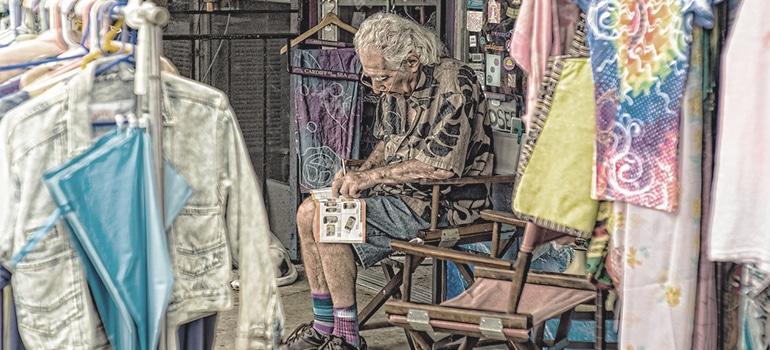 an old man writing a list